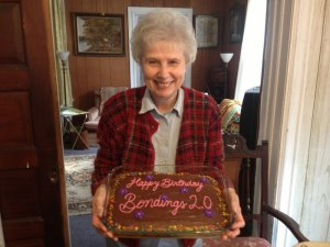 New Ways Ministry co-founder Sister Jeannine Gramick poses with Bondings 2.0's birthday cake!