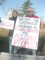 Jackie and Buzz Baetz proclaim their message of Catholic support for marriage equality outside the Supreme Court.