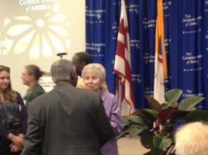 Sr. Jeannine Gramick speaking with Cardinal Turkson at The Catholic University of America