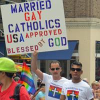 Nicholas and David march in NYC Pride parade.