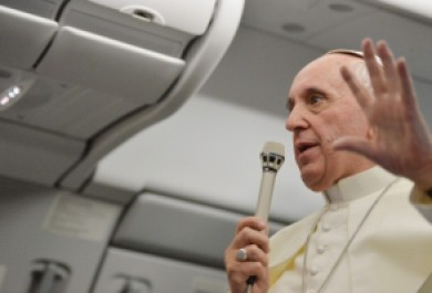 Pope Francis on plane