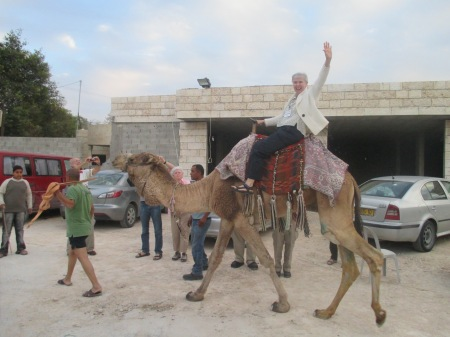 Sister Jeannine Gramick takes a ride on Jaguar, the camel.